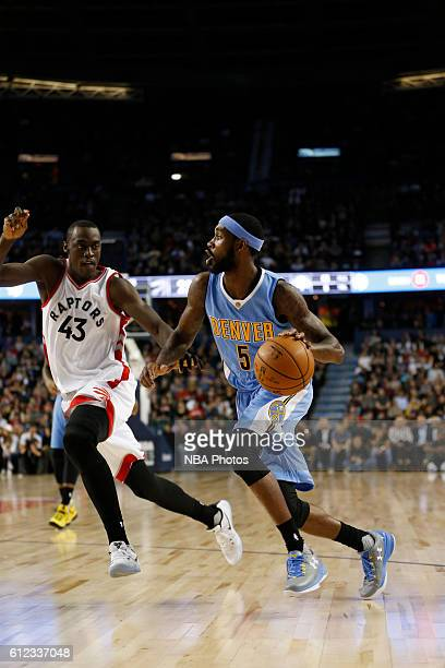 Will Barton of the Denver Nuggets handles the ball against the Toronto Raptors on October 3 2016 at the Scotiabank Saddledome in Calagary Alberta...