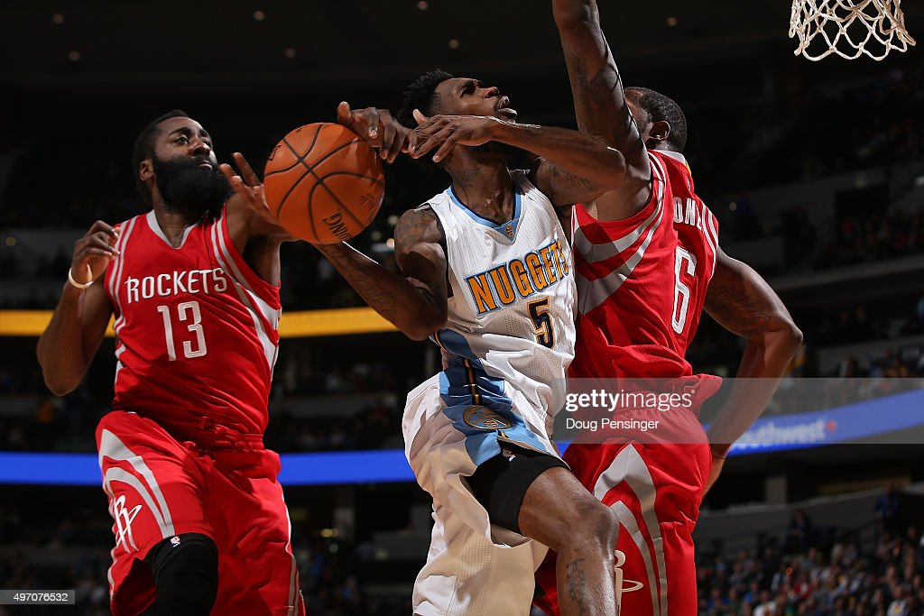 Will Barton of the Denver Nuggets has his shot blocked by James Harden of the Houston Rockets as Terrence Jones of the Houston Rockets helps with the...