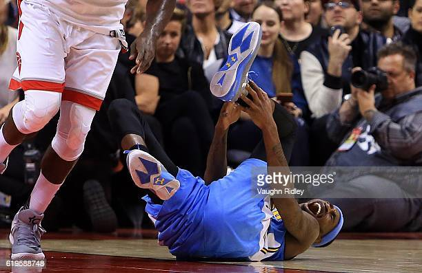 Will Barton of the Denver Nuggets injures his ankle during the second half of an NBA game against the Toronto Raptors at Air Canada Centre on October...