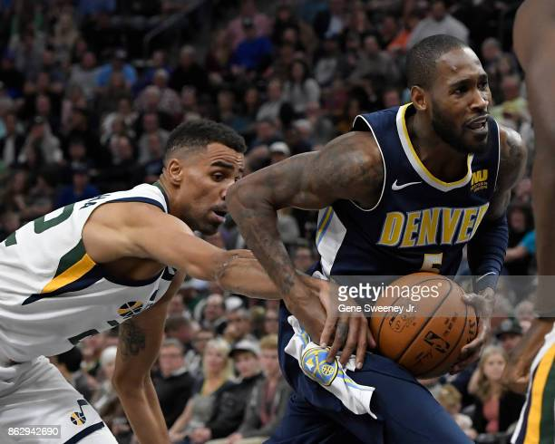 Will Barton of the Denver Nuggets is fouled in the second half of their 10696 loss by Thabo Sefolosha of the Utah Jazz at Vivint Smart Home Arena on...