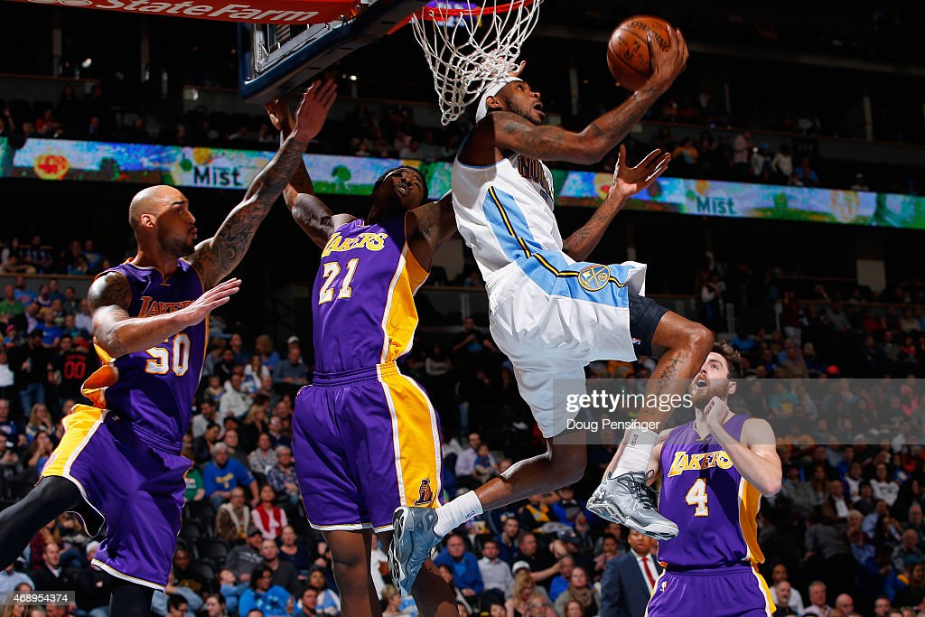 Will Barton #5 of the Denver Nuggets lays up a shot against Robert Sacre #50, Ed Davis #21 and Ryan Kelly #4 of the Los Angeles Lakers at Pepsi Center on April 8, 2015 in Denver, Colorado.