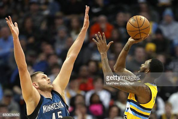 Will Barton of the Denver Nuggets puts up a shot against Cole Aldrich of the Minnesota Timberwolves at the Pepsi Center on December 28 2016 in Denver...