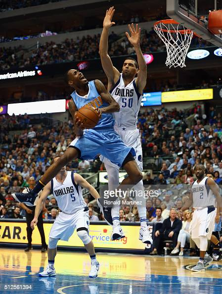 Will Barton of the Denver Nuggets takes a shot against Salah Mejri of the Dallas Mavericks during the first half at American Airlines Center on...