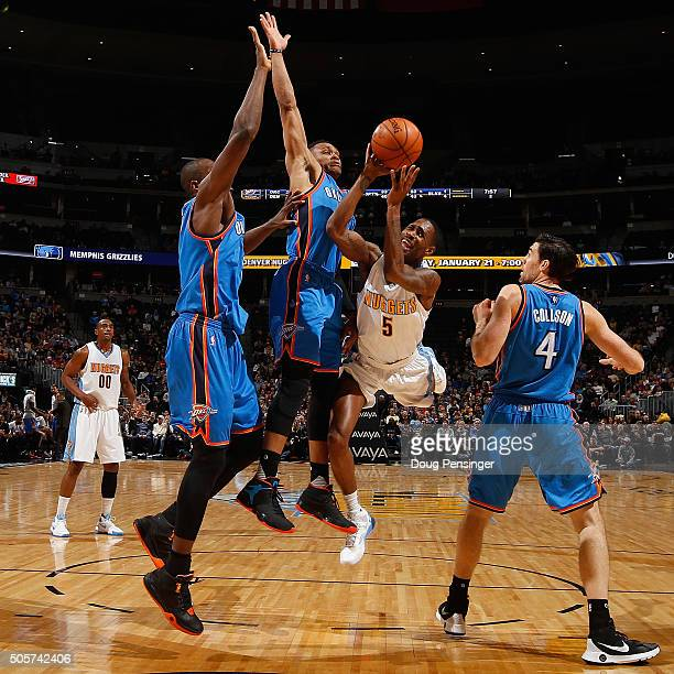Will Barton of the Denver Nuggets tries to get off a shot against the defense of Kevin Durant Russell Westbrook and Nick Collison of the Oklahoma...