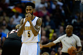 Will Barton of the Denver Nuggets warms up his hands during the first quarter at the Pepsi Center on January 3 2016 in Denver Colorado