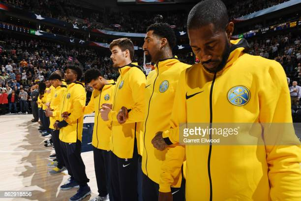 Will Barton of the Denver Nuggets with his teammates stand for the National Anthem before the game against the Utah Jazz on October 18 2017 at...