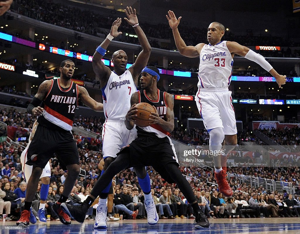 Will Barton #5 of the Portland Trail Blazers attempts his shot in front of Lamar Odom #7 and Grant Hill #33 of the Los Angeles Clippers as teammate LaMarcus Aldridge #12 waits at Staples Center on January 27, 2013 in Los Angeles, California.