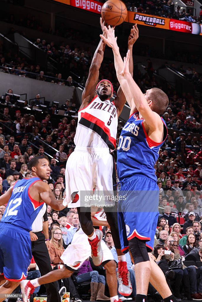 Will Barton #5 of the Portland Trail Blazers battles for the ball control with Spencer Hawes #00 of the Philadelphia 76ers during the game between the Philadelphia 76ers and the Portland Trail Blazers on December 29, 2012 at the Rose Garden Arena in Portland, Oregon.