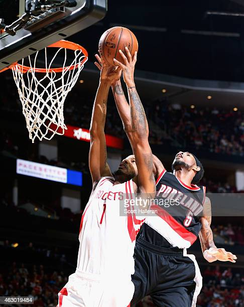 Will Barton of the Portland Trail Blazers blocks a shot behind Trevor Ariza of the Houston Rockets during their game at the Toyota Center on February...