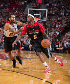 Will Barton of the Portland Trail Blazers drives on teammate Allen Crabbe of the Portland Trail Blazers while participating in the team's annual 'Fan...