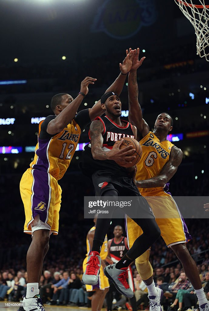 Will Barton #5 of the Portland Trail Blazers drives to the basket between Dwight Howard #12 and Earl Clark #6 of the Los Angeles Lakers in the second half at Staples Center on February 22, 2013 in Los Angeles, California. The Lakers defeated the Trail Blazers 111-107.