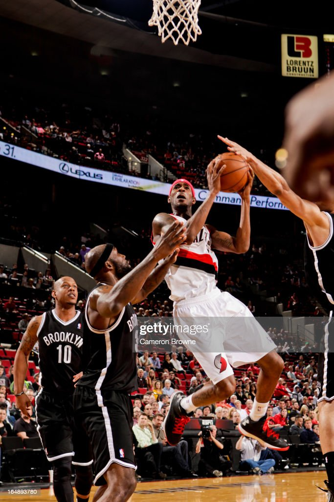 <a gi-track='captionPersonalityLinkClicked' href=/galleries/search?phrase=Will+Barton&family=editorial&specificpeople=6894020 ng-click='$event.stopPropagation()'>Will Barton</a> #5 of the Portland Trail Blazers drives to the basket against <a gi-track='captionPersonalityLinkClicked' href=/galleries/search?phrase=Reggie+Evans&family=editorial&specificpeople=202254 ng-click='$event.stopPropagation()'>Reggie Evans</a> #30 of the Brooklyn Nets on March 27, 2013 at the Rose Garden Arena in Portland, Oregon.