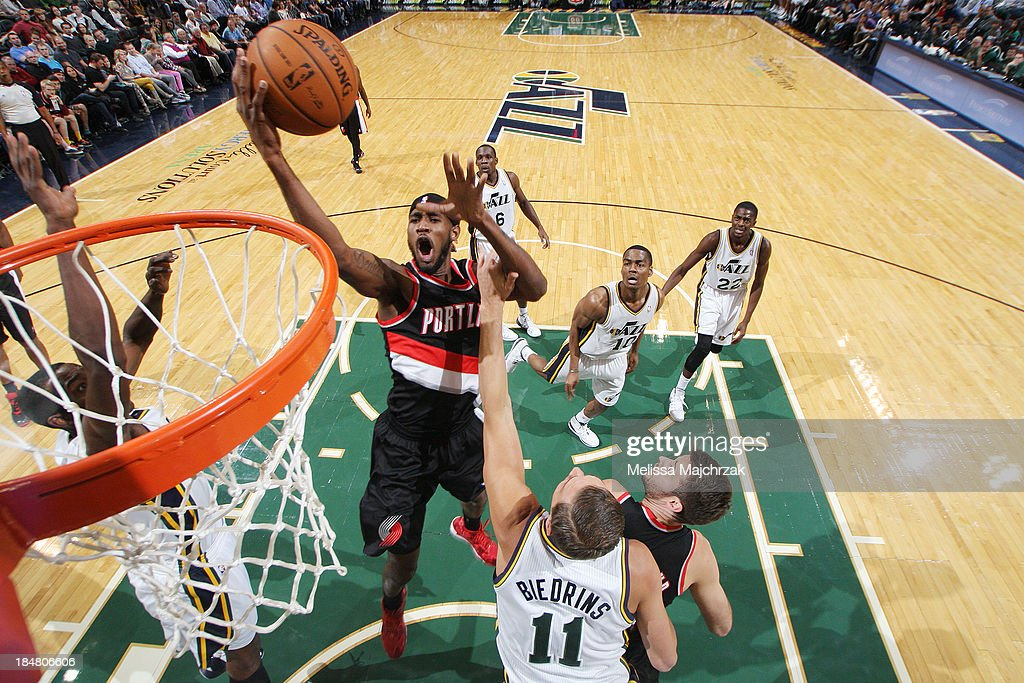 <a gi-track='captionPersonalityLinkClicked' href=/galleries/search?phrase=Will+Barton&family=editorial&specificpeople=6894020 ng-click='$event.stopPropagation()'>Will Barton</a> #5 of the Portland Trail Blazers drives to the hoop against <a gi-track='captionPersonalityLinkClicked' href=/galleries/search?phrase=Andris+Biedrins&family=editorial&specificpeople=204473 ng-click='$event.stopPropagation()'>Andris Biedrins</a> #11 of the Utah Jazz at Energy Solutions Arena on October 16, 2013 in Salt Lake City, Utah.