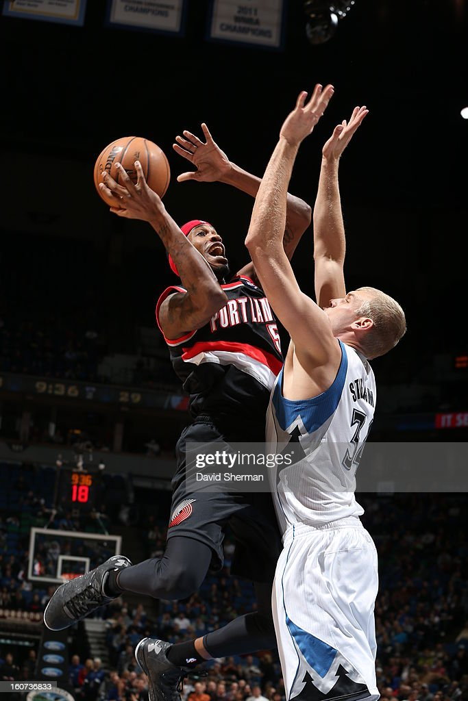 Will Barton #5 of the Portland Trail Blazers goes to the basket against Greg Stiemsma #34 of the Minnesota Timberwolves during the game between the Minnesota Timberwolves and the Portland Trail Blazers on February 4, 2013 at Target Center in Minneapolis, Minnesota.