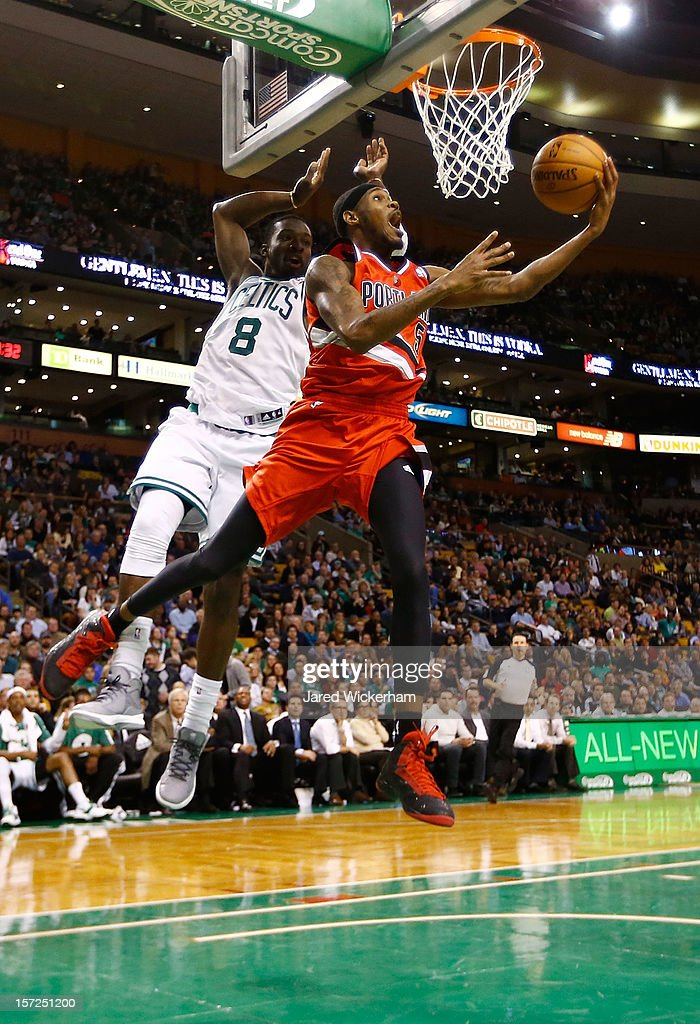 Will Barton #5 of the Portland Trail Blazers goes up and around for a layup in front of Jeff Green #8 of the Boston Celtics during the game on November 30, 2012 at TD Garden in Boston, Massachusetts.
