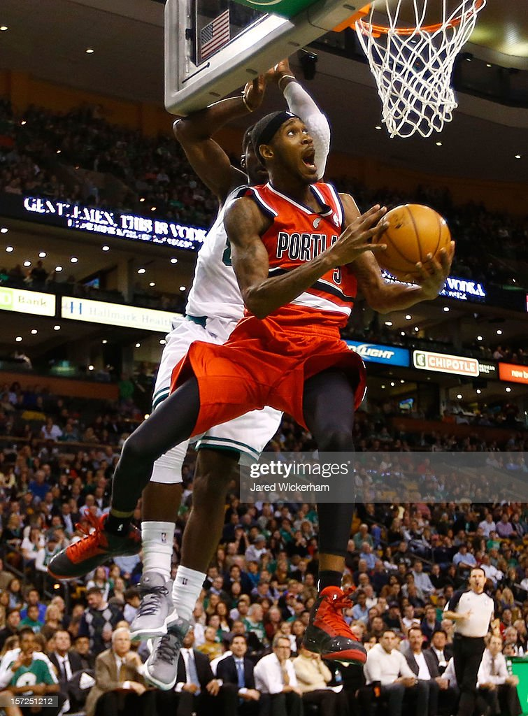 <a gi-track='captionPersonalityLinkClicked' href=/galleries/search?phrase=Will+Barton&family=editorial&specificpeople=6894020 ng-click='$event.stopPropagation()'>Will Barton</a> #5 of the Portland Trail Blazers goes up and around for a layup in front of Jeff Green #8 of the Boston Celtics during the game on November 30, 2012 at TD Garden in Boston, Massachusetts.
