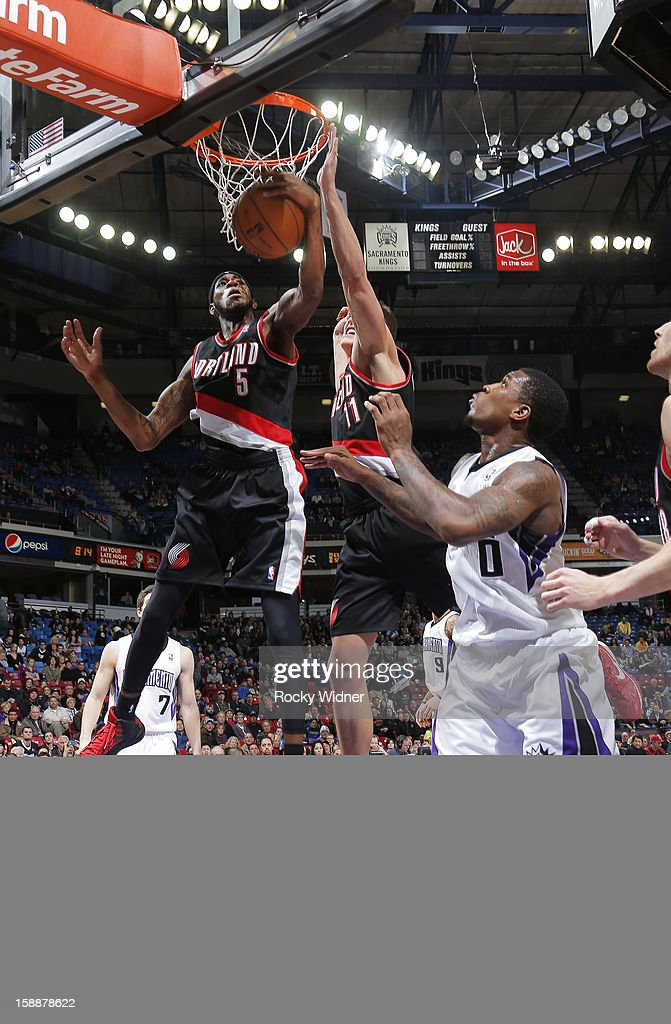 <a gi-track='captionPersonalityLinkClicked' href=/galleries/search?phrase=Will+Barton&family=editorial&specificpeople=6894020 ng-click='$event.stopPropagation()'>Will Barton</a> #5 of the Portland Trail Blazers grabs the rebound against Thomas Robinson #0 of the Sacramento Kings on December 23, 2012 at Sleep Train Arena in Sacramento, California.