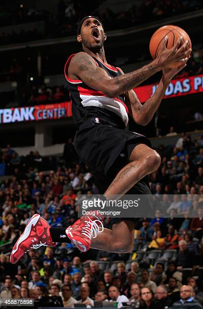 Will Barton of the Portland Trail Blazers lays up a shot against the Denver Nuggets at Pepsi Center on November 12 2014 in Denver Colorado NOTE TO...