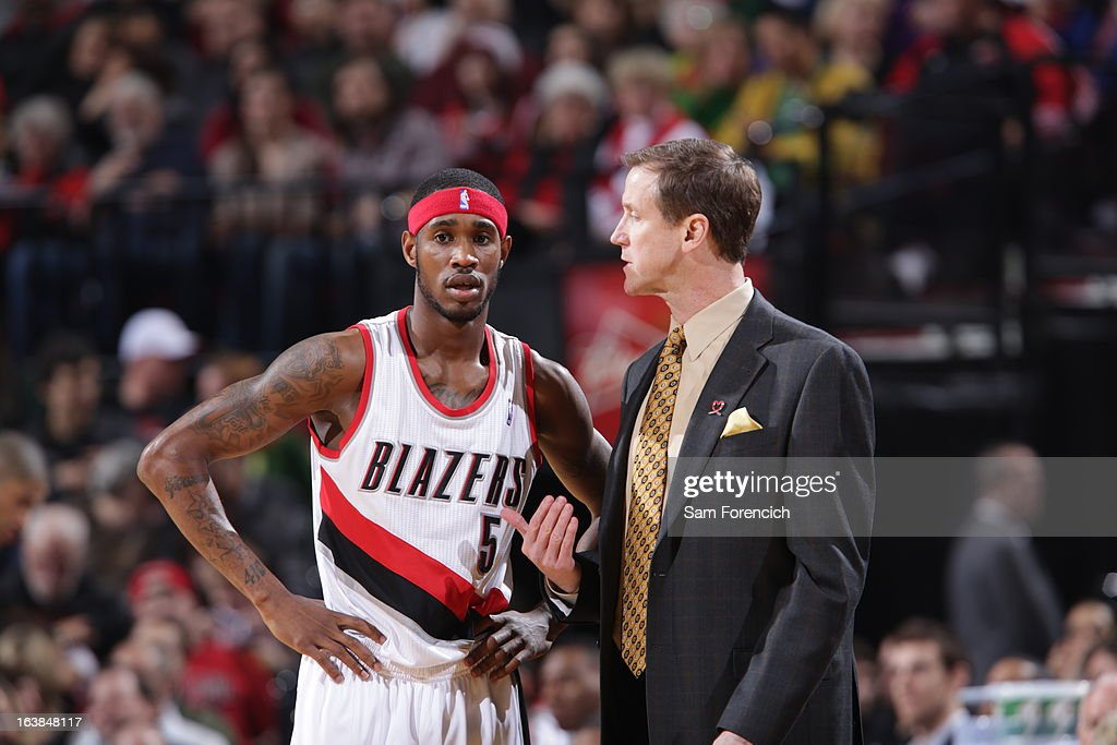 Will Barton #5 of the Portland Trail Blazers listens to Head Coach Terry Stotts of the Portland Trail Blazers during the game between the Detroit Pistons and the Portland Trail Blazers on March 16, 2013 at the Rose Garden Arena in Portland, Oregon.