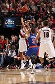 Will Barton of the Portland Trail Blazers passes against Jose Calderon of the New York Knicks on December 328 2014 at the Moda Center in Portland...