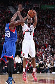 Will Barton of the Portland Trail Blazers shoots the ball against the Philadelphia 76ers on December 26 2014 at the Moda Center Arena in Portland...