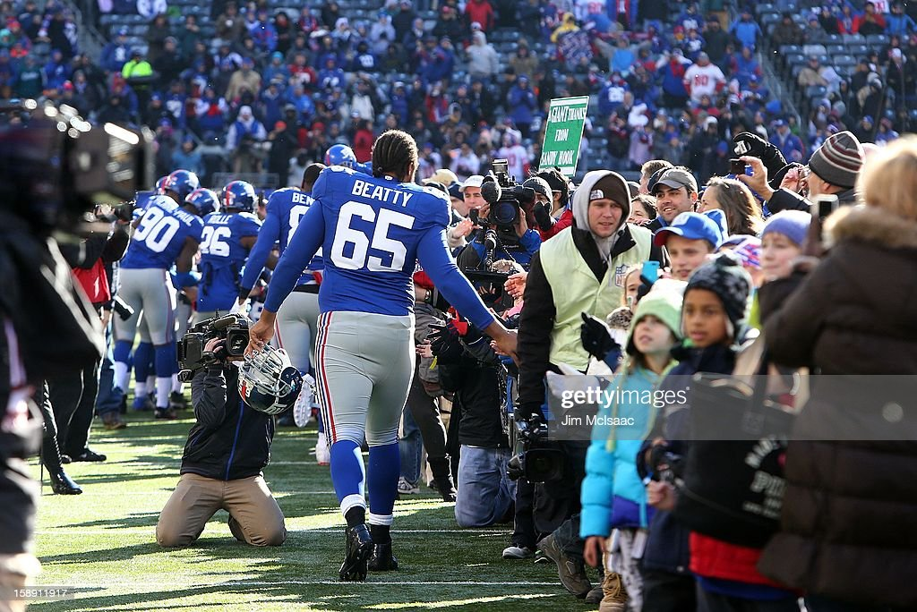 Will Beatty #65 of the New York Giants greets students, parents and faculty of Sandy Hook Elementary School as well as residents of Newtown, Connecticut as they attend the NFL game between the New York Giants and the Philadelphia Eagles at MetLife Stadium on December 30, 2012 in East Rutherford, New Jersey. The Giants defeated the Eagles 42-7.