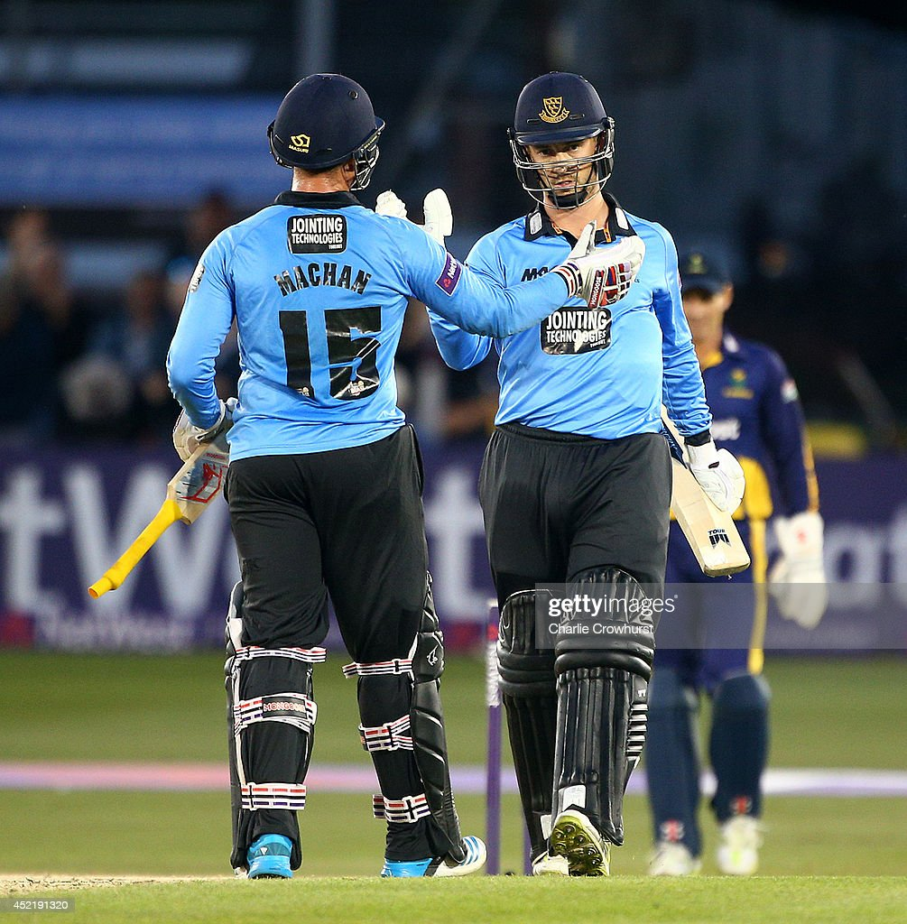 Will Beer (R) and Matthew Machan of Sussex celebrate after winning the match during the Natwest T20 Blast match between Sussex Sharks and Glamorgan at The BrightonAndHoveJobs.com County Ground on July 15, 2014 in Hove, England.