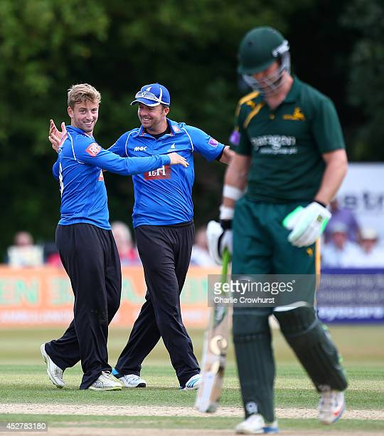 Will Beer of Sussex celebrates catching and bowling Nottinghamshire's James Franklin with team mates Chris Nash during Royal London OneDay Cup match...