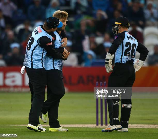 Will Beer of Sussex celebrates with Chris Nash and Ben Brown of Sussex after taking the wicket of Sam Curran of Surrey during the NatWest T20 Blast...