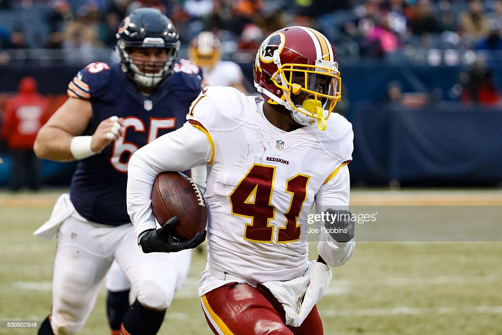 Will Blackmon #41 of the Washington Redskins carries the football after intercepting against the Chicago Bears in the fourth quarter at Soldier Field on December 24, 2016 in Chicago, Illinois. The Washington Redskins defeated the Chicago Bears 41-21.