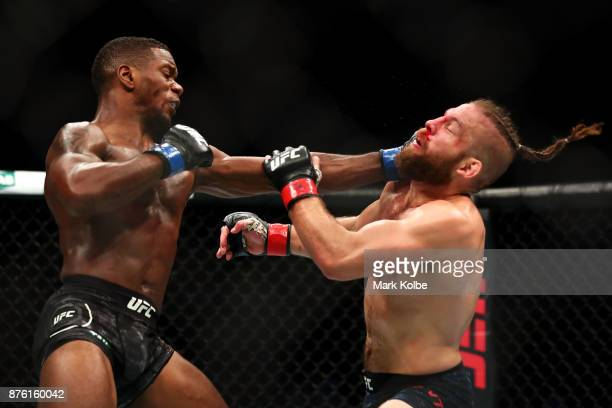 Will Brooks of the USA punches Nik Lentz of the USA in their lightweight bout during the UFC Fight Night at Qudos Bank Arena on November 19 2017 in...