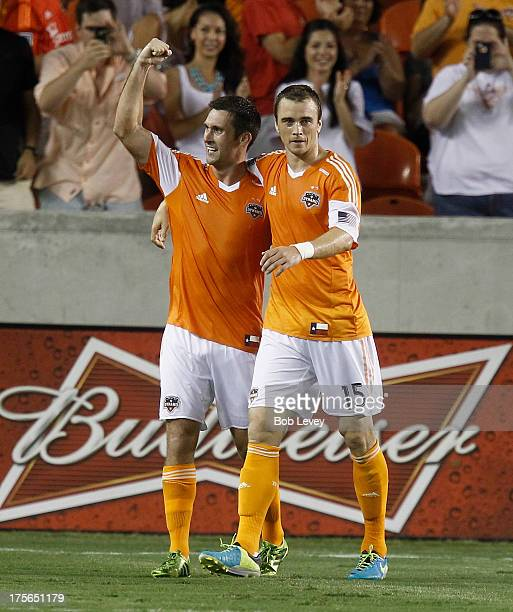 Will Bruin and Cam Weaver of Houston Dynamo celebrate after Weaver scored in the second half against the Columbus Crew at BBVA Compass Stadium on...