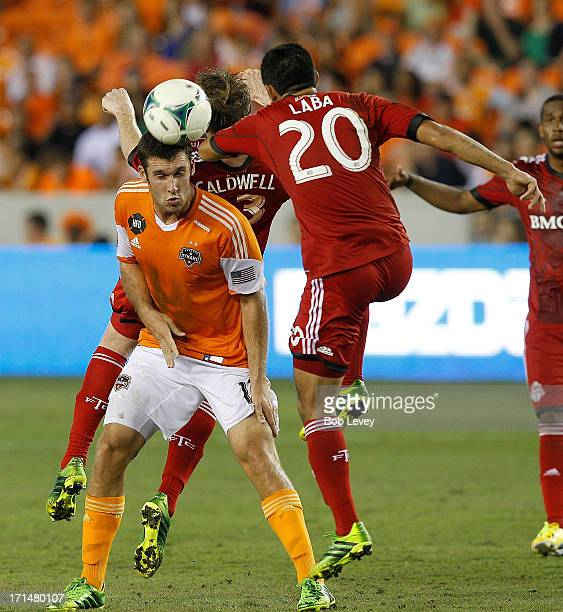 Will Bruin of Houston Dynamo and Matias Laba of Toronto FC during the game action at BBVA Compass Stadium on June 22 2013 in Houston Texas