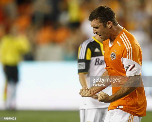 Will Bruin of Houston Dynamo celebrates after scoring in the second half against the Columbus Crew at BBVA Compass Stadium on August 3 2013 in...