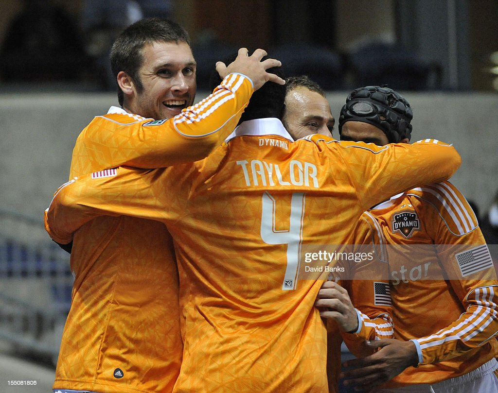 Will Bruin #12 of Houston Dynamo (L) celebrates his goal with <a gi-track='captionPersonalityLinkClicked' href=/galleries/search?phrase=Jermaine+Taylor+-+Soccer+Player&family=editorial&specificpeople=13524207 ng-click='$event.stopPropagation()'>Jermaine Taylor</a> #4 against the Chicago Fire in an MLS match on October 31, 2012 at Toyota Park in Bridgeview, Illinois.