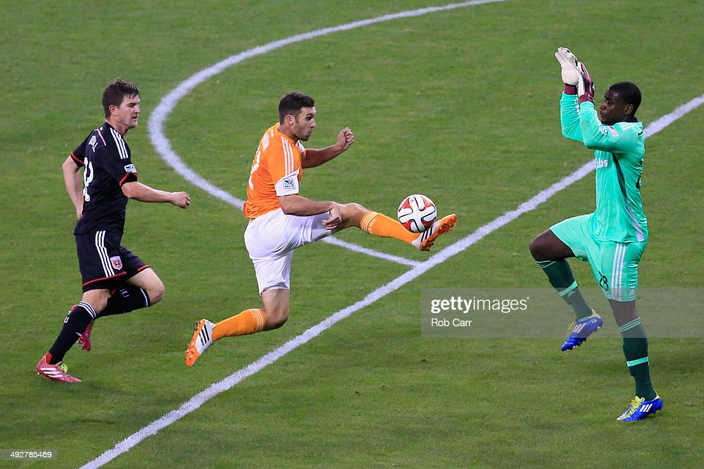 <a gi-track='captionPersonalityLinkClicked' href=/galleries/search?phrase=Will+Bruin&family=editorial&specificpeople=7433613 ng-click='$event.stopPropagation()'>Will Bruin</a> #12 of Houston Dynamo moves the ball past <a gi-track='captionPersonalityLinkClicked' href=/galleries/search?phrase=Bobby+Boswell+-+Soccer+Player&family=editorial&specificpeople=587535 ng-click='$event.stopPropagation()'>Bobby Boswell</a> #32 and goalie <a gi-track='captionPersonalityLinkClicked' href=/galleries/search?phrase=Bill+Hamid&family=editorial&specificpeople=4417249 ng-click='$event.stopPropagation()'>Bill Hamid</a> #28 of D.C. United during the second half at RFK Stadium on May 21, 2014 in Washington, DC.