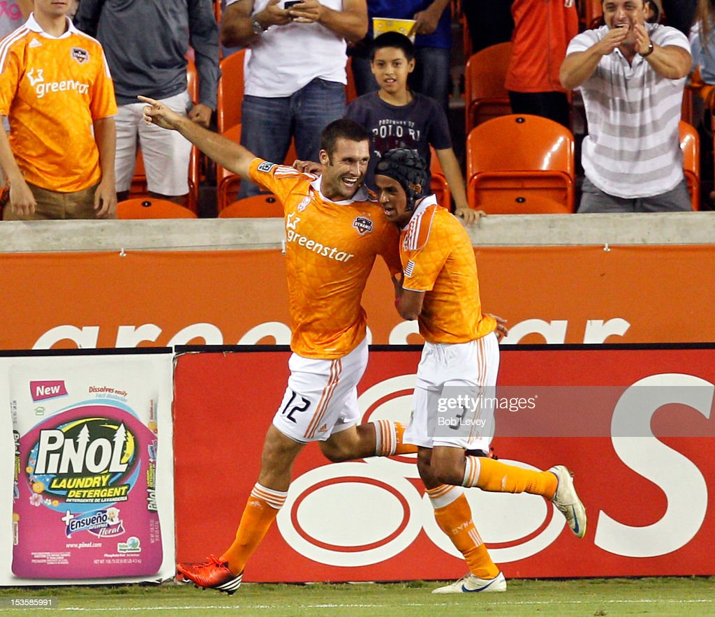 Will Bruin of the Houston Dynamo and Calen Carr of the Houston Dynamo celebrate Bruin's goal in the first half against the Montreal Impact at BBVA...