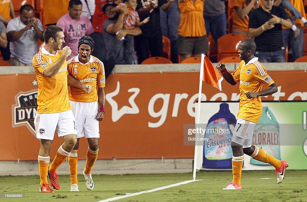Will Bruin of the Houston Dynamo and Calen Carr of the Houston Dynamo along with Boniek Garcia of the Houston Dynamo celebrate Bruin's goal in the...