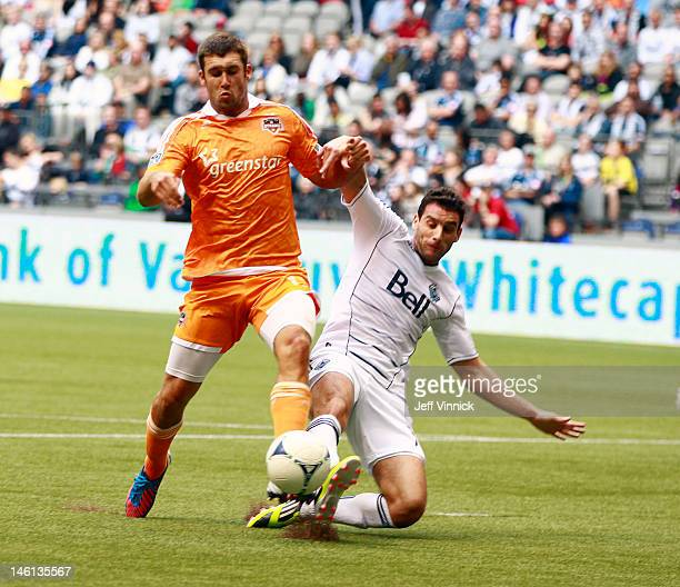 Will Bruin of the Houston Dynamo and Martin Bonjour of the Vancouver Whitecaps FC are locked in battle during their MLS game June 10 2012 in...