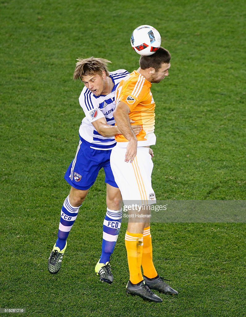 Will Bruin #12 of the Houston Dynamo battles for the ball with Walker Zimmerman #25 of FC Dallas during their game at BBVA Compass Stadium on March 12, 2016 in Houston, Texas.