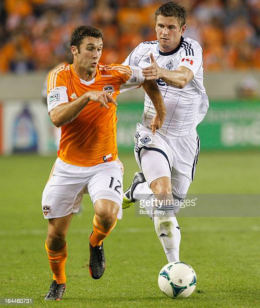 Will Bruin of the Houston Dynamo battles with Brad Rucin of the Vancouver Whitecaps at BBVA Compass Stadium on March 23 2013 in Houston Texas Houston...