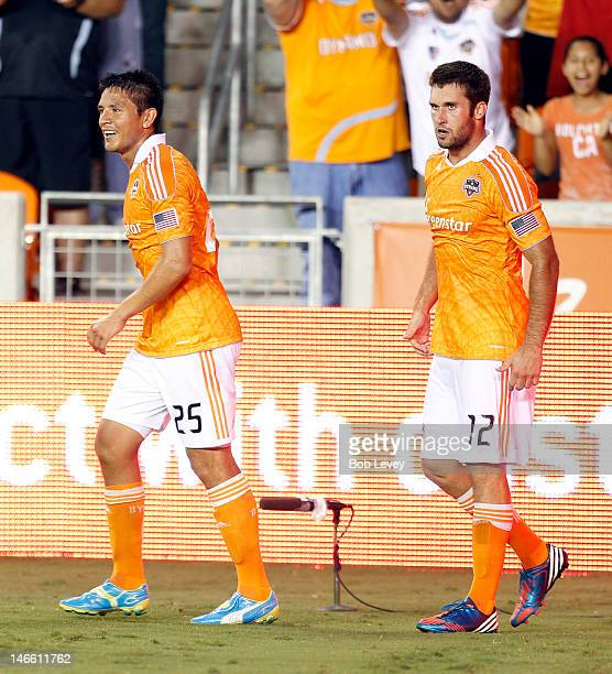 Will Bruin of the Houston Dynamo celebrates with Brian Ching of the Houston Dynamo after scoring in the second half late in the game to tie the game...