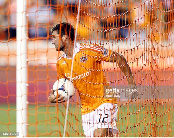 Will Bruin of the Houston Dynamo grabs the ball out of the goal after scoring in the second half against Toronto FC at BBVA Compass Stadium on June...