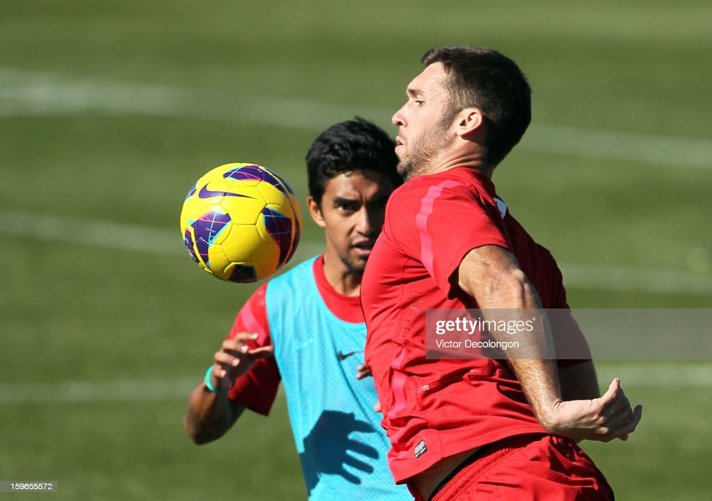Will Bruin plays the ball off his chest as A.J. DeLaGarza (light blue jersey) defends the play during the U.S. Men's Soccer Team training session at the Home Depot Center on January 17, 2013 in Carson, California.
