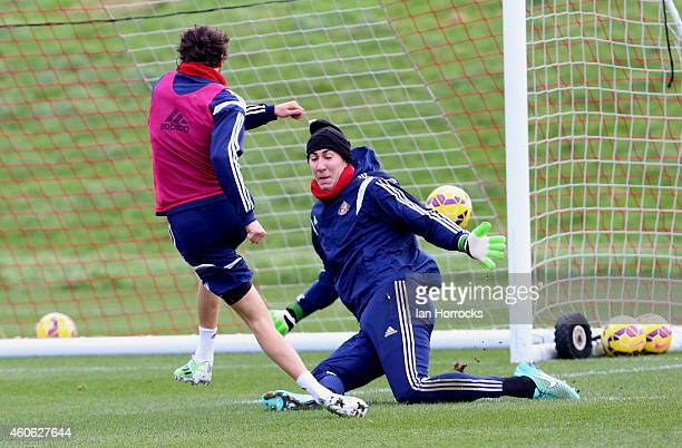 Will Buckley fires a shot past Costel Pantilimon during a Sunderland AFC Training Session at the Academy of Light on December 18 2014 in Sunderland...