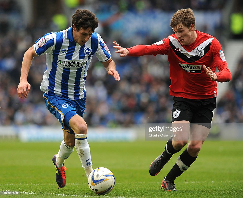 Will Buckley of Brighton & Hove Albion attacks Huddersfield's Paul Dixon during the npower Championship match between Brighton & Hove Albion and Huddersfield Town at The Amex Stadium on March 02, 2013 in Brighton England.