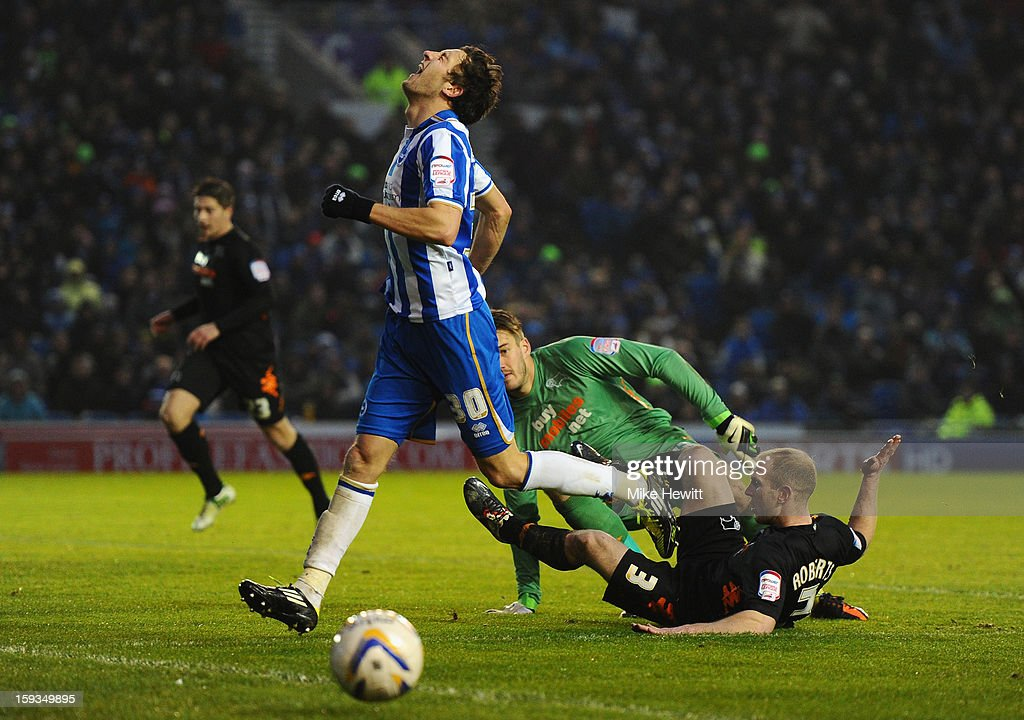 Will Buckley of Brighton reacts after being denied a goal by Adam Legzdins and Gareth Roberts of Derby during the npower Championship match between Brighton & Hove Albion and Derby County at Amex Stadium on January 12, 2013 in Brighton, England.