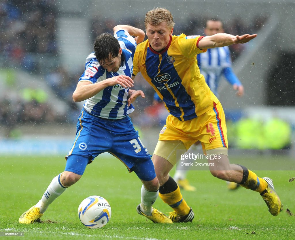 Will Buckley of Brighton tries to hold off Jonathan Parr of Crystal Palace during the npower Championship match between Brighton & Hove Albion and Crystal Palace at The Amex Stadium on March 17, 2013 in Brighton, England,