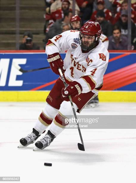 Will Butcher of the Denver Pioneers controls the puck against the Notre Dame Fighting Irish during game two of the 2017 NCAA Division I Men's Hockey...