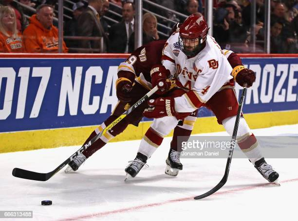 Will Butcher of the Denver Pioneers is pressured by Parker Mackay of the MinnesotaDuluth Bulldogs during the 2017 NCAA Division I Men's Ice Hockey...